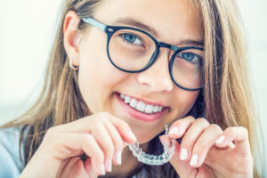 Girl with Invisalign braces from Sullivan Bastian Orthodontics in Mill Creek, Wa